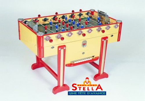 Photo et descriptif: La Passion du Billard baby foot stella Champion Rétro jaune avec monnayeur.